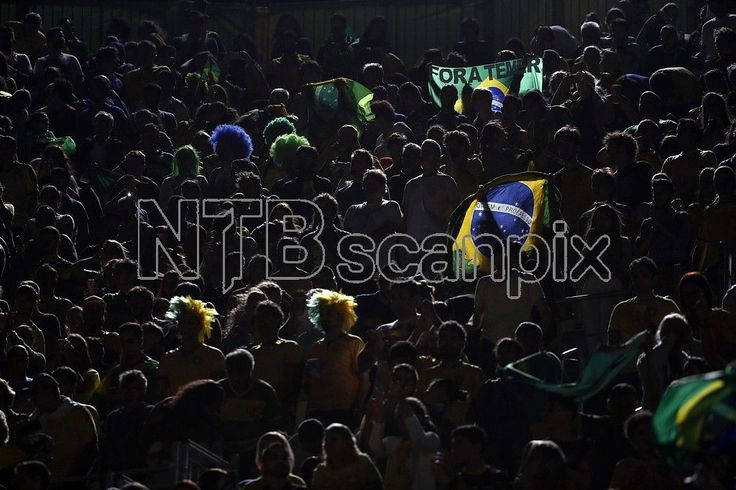 The slogan 'Temer Out' can be read on a Brazilian flag as fans of Brazil cheer prior the women's Beach Volleyball Final match of the Rio 2016 Olympic Games between Ludwig/Walkenhorst of Germany and Agatha/Barbara of Brazil at the Beach Volleyball Arena on Copacabana Beach in Rio de Janeiro, Brazil, August 2016. EPA/ORLANDO BARRIA