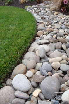 putting rock border around house foundations - Google Search