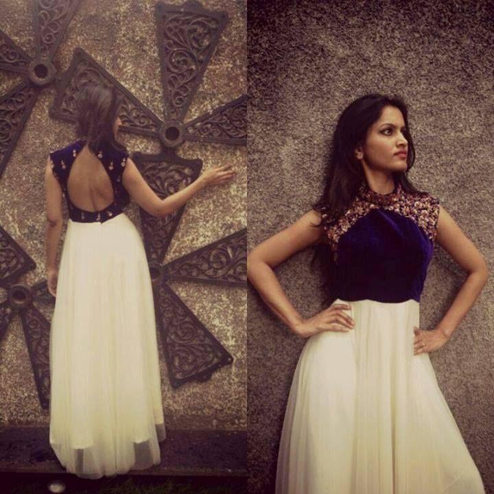 White floor length anarkali with golden thread work on navy blue yolk, high neck, sleeveless and back open. Anitha Reddy Designs.
