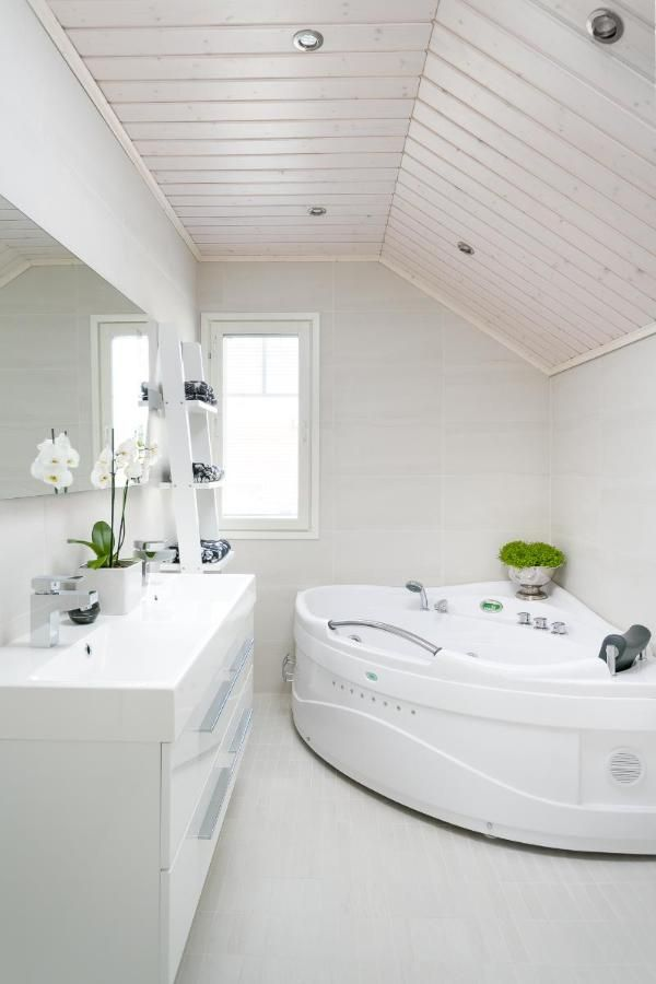 Simple white bathroom with a corner jetted tub!