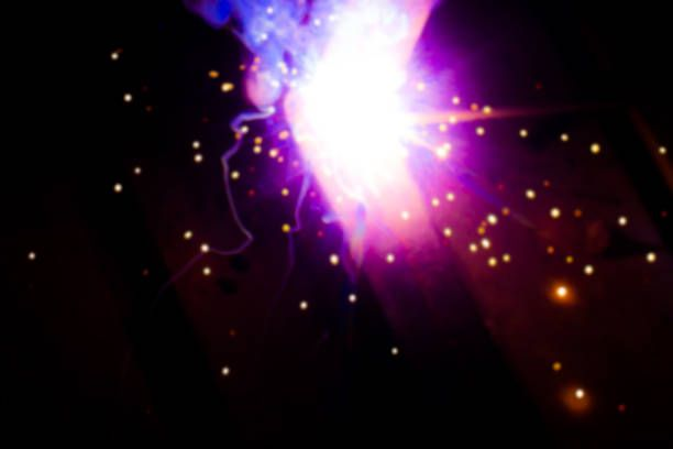 luminous abstractions as a result of electric welding purple flashes
