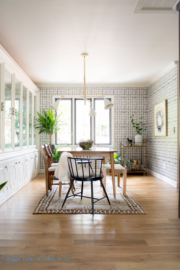 Eclectic Mid Century Dining Room With Wood Flooring Vintage Rug Plants And Wallpaper