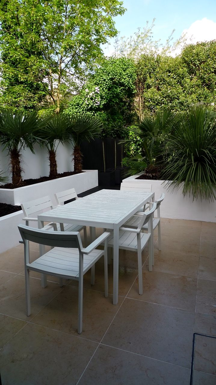 Modern Urban London Garden Design limestone paving white raised beds black decking architectural planting (8)