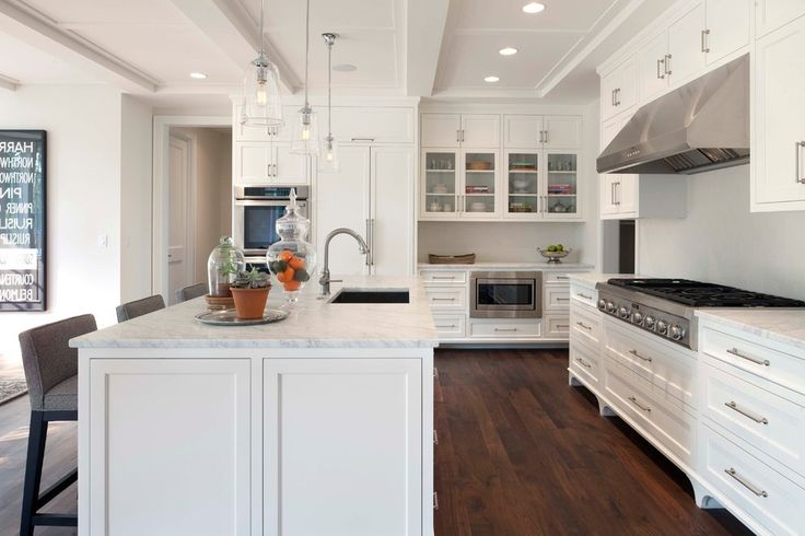 White Washed Cabinets with Bathroom Sconces Subway Tile and Yellow Oil Rubbed Bronze Faucet
