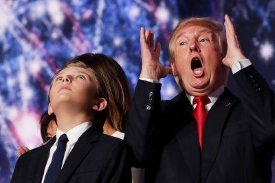 Funniest photos of world leaders from 2016:     Politicians 2016:    Republican presidential candidate Donald Trump reacts as his son Barron Trump looks on at the end of the Republican National Convention at the Quicken Loans Arena in Cleveland, Ohio on 21 July 2016.   Chip Somodevilla/Getty Images