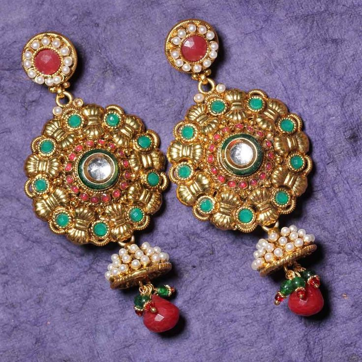 This gorgeous pair of earrings is designed to make you even beautiful. These danglers are sure to enchant any women's heart! Grab these beautiful earrings to make any woman jealous around you!      Fashion Statement      All you need is a sexy sari, lehenga or a suit to adorn this overwhelming piece of jewelry. And why restrict it to traditional wears only, jazz up your sexy LBD with these earrings.