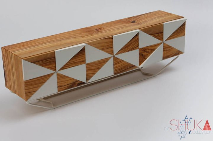 The Shuka Collection by Claudia Kießling//Ikghuphu is inspired by the wallpaintings of the Ndebele women. It's a low but wide console with two doors and two drawers made of native olive wood and powdercoated steel