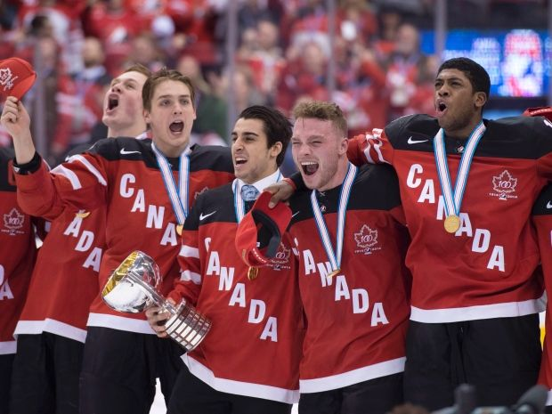 Canadian players celebrate with their medals after defeating Russia 5-4 in the gold-medal game at the world junior hockey championship Monday night at Air Canada Centre in Toronto.