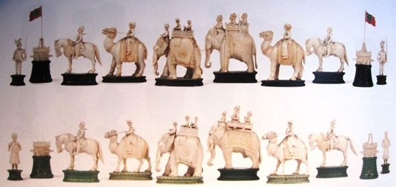 An East India (John Company) ivory figural part or composite chess set, Berhampur, circa 1840, Indian States versus the British