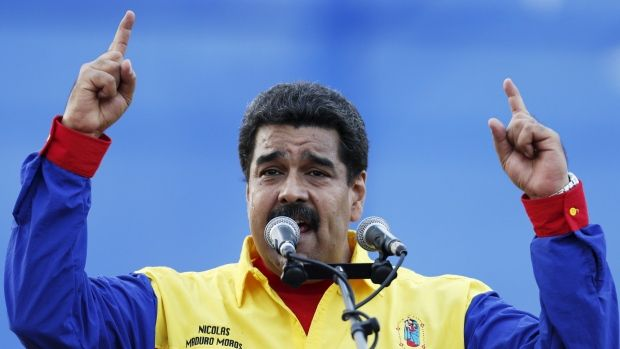Venezuela President Nicolas Maduro speaks in Caracas during the last campaign rally with pro-government candidates for the upcoming parliamentary elections. Venezuela is holding parliamentary elections today.
