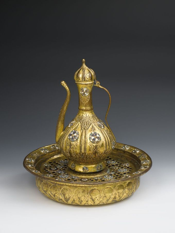 decorated with stones, silver pitcher and tray