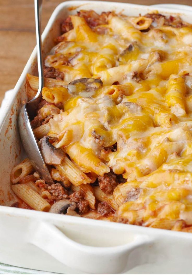 Cheesy Pasta Bake with Triple Cheddar Cheese, Ground Beef, Mushrooms, Onion, Bacon, Spaghetti Sauce, and Italian Seasoning. It's So Delicious!!
