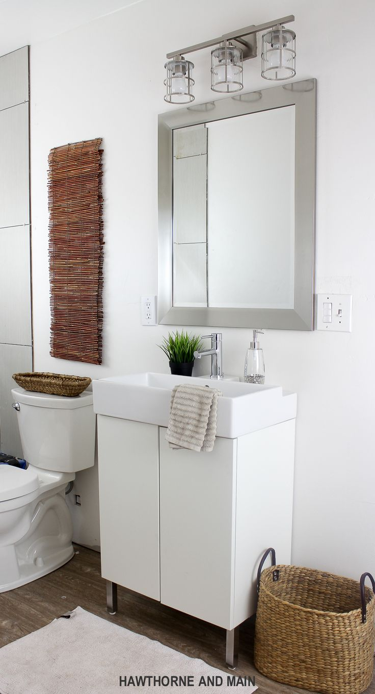 Weave pattern honed in a mesh on unfinished furniture bathroom vanity - Simple Bathroom Update I Love That Mirror And Light Such A Great Bathroom