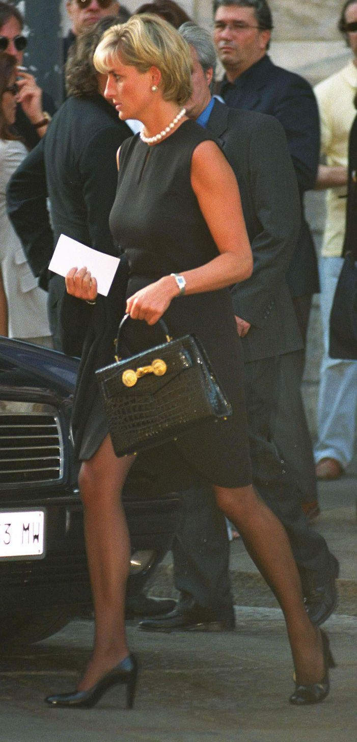 "The Princess of Wales was at Milan's gothic cathedral on 22 July 1997 for the memorial service of her friend Gianni Versace, who once called her ""The Mother Teresa and Cindy Crawford of our time"". She wears his black shift-dress and leather Kelly bag with Medusa heads, re-named ""the Diana bag"". Diana comforted Elton John during the service. By a tragic twist of fate, he was to sing at her funeral service just a few weeks later."