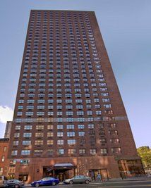 This large, red-brick, 35-story apartment tower is in a prime Upper East Side location, adjacent to Grace's Marketplace food
