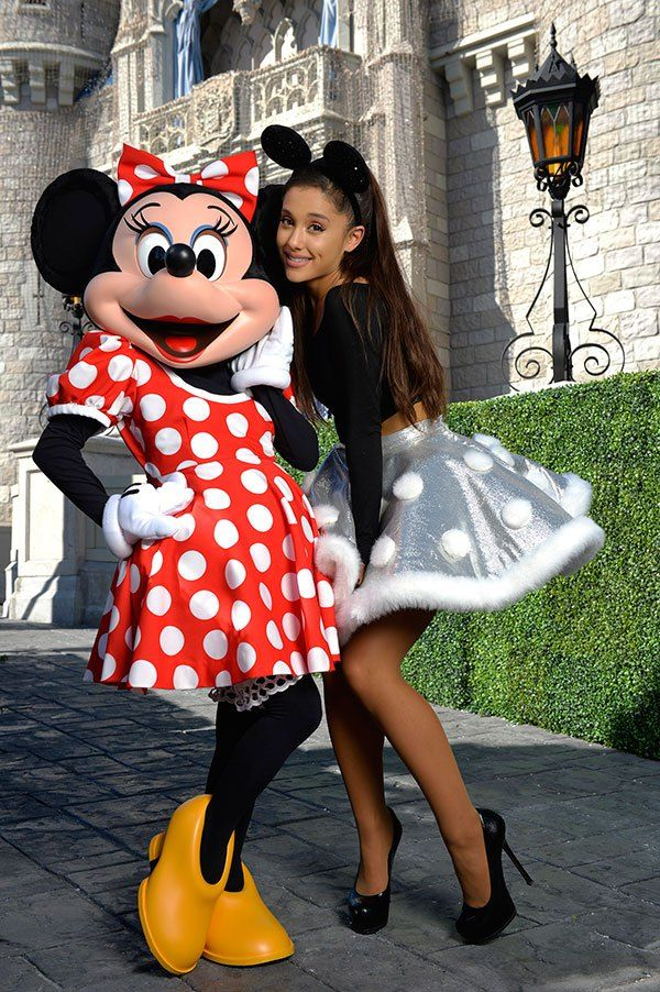 Ariana Grande struck a cute pose with Minnie Mouse at the 'Disney Parks Unforgettable Christmas Celebration' TV special!