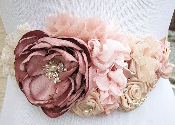 Vintage Rose blush, Champagne, Pink Fabric Flowers Sash - Swarovski Crystal and Pearls Embellished Belt is good for a Bride, Maid of Honor Bella collection!!!! This sash is made of variety of fabric flowers. Focal flower is in vintage rose surrounded by blush, pink, nude and champagne color flowers. Pear, navette (boat) & round shaped Swarovski sew on crystals, pearls and silver plated beads are used to embellish this sash. All embellishments are hand sewn. It is a made to order item and…