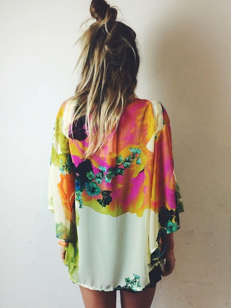 Watercolor kimono. Festival/ Boho chic. Half top knot bun and a tan to boot. Wear Kimono on numerous occasions, from afternoon lunch to night out. Accessorizing is key.