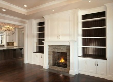 I wonder how this would look? Shelves where the fireplace is but the cabinets like that in the middle?