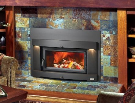 Perfect-Fit Plus Wood Fireplace Insert by Avalon  Available at Porters in Riverton and Casper Wyoming Porter's Price Starting As Low As   Transform your old masonry fireplace with the clean, contemporary, sleek design of the Perfect-Fit Plus wood insert with the Cypress™ face. With no visible grills or venting the insert adds a polished touch to a modern decor while serving as a super-efficient heat source. The insert also features the unobstructed air wash system maintaining clarity and…
