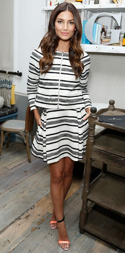 Lily Aldridge celebrated her Fall Refresh collection for Gilt and BluePrint Juice in a black-and-white striped jacket and matching skirt by Thakoon, adding a pop of color with playful Sophia Webster sandals.