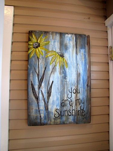 You are my sunshine - kids each paint a flower. pallet boards and distressed paint for background.