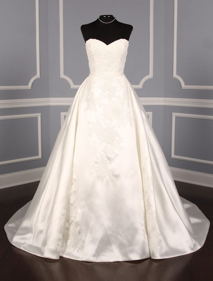 This Pronovias Primura wedding dress is made from luxurious ivory silk mikado accented with Chantilly lace appliques. Perfect for any type of wedding venue!