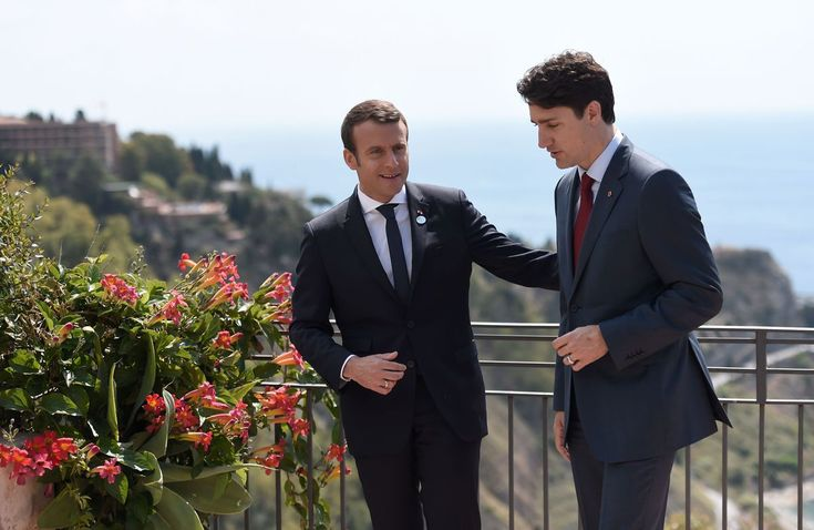 Canadian Prime Minister Justin Trudeau (R) and French President Emmanuel Macron talk during a bilateral meeting as they attend the Summit of the Heads of State and of Government of the G7, the group of most industrialized economies, plus the European Union, on May 26, 2017 in Taormina, Sicily. The leaders of Britain, Canada, France, Germany, Japan, the US and Italy will be joined by representatives of the European Union and the International Monetary Fund (IMF) as well as teams from…