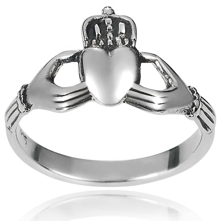 This beautiful ring by Journee Collection is constructed of premium sterling silver with a polished finish. The design of this ring features a slender band with a crowning claddagh design. Brand: Jour