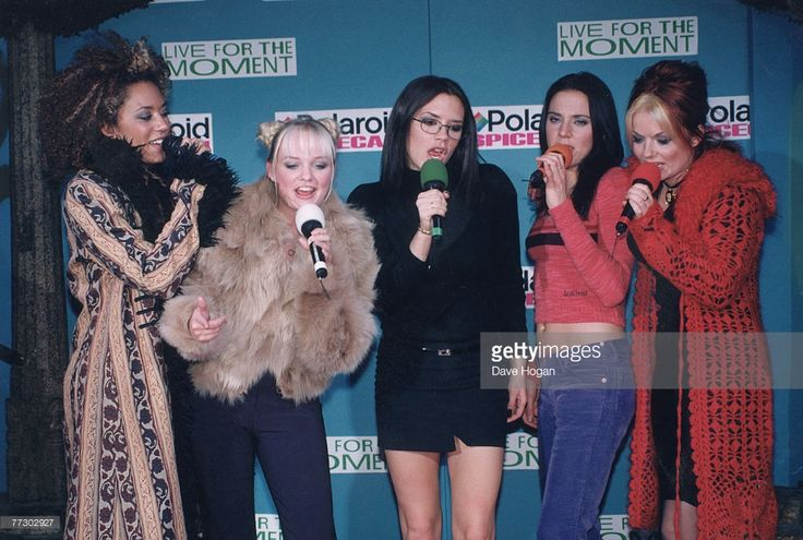From left to right, Melanie Brown (aka Mel B or Scary Spice), Emma Bunton (aka Baby Spice), Victoria Beckham (aka Posh Spice), Melanie Chisholm (aka Mel C or Sporty Spice) and Geri Halliwell (aka Ginger Spice) of British pop group the Spice Girls, during a publicity campaign for the Polaroid SpiceCam camera, 1997.