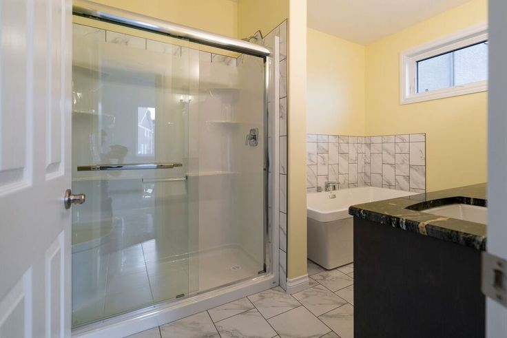 Huge shower and a stunning tub! #loveyourhome #buildwithharmony