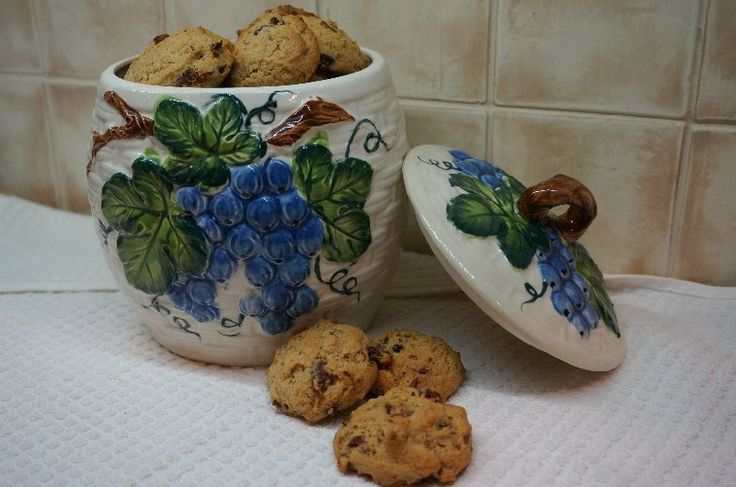 Boiled Raisin Cookies in Grandma's Cookie Jar ~  Says at Mennonite Girls Can Cook: This cookie jar always had a prominent place in Ella Klassen's kitchen. The cookies I remember her baking most often were these Boiled Raisin Cookies - they were soft and moist, full of raisins, walnuts and aromatic spices.