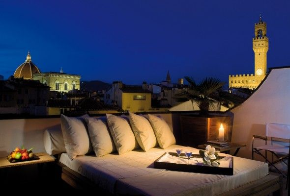 """Palazzo Vecchio penthouse   of the Gallery Hotel Art   """"...the crowning glory of the space was the terrazza itself, which offered breathtaking views of the Duomo, the Palazzo, and the surrounding hills. Julia envisioned curling up with Gabriel on the comfortable futon bed, which dominated the terrace, with a glass of Chianti, looking up at the stars. Or perhaps (she blushed), making love with him by candlelight underneath those same stars.  Orgasms with Gabriel by starlight…""""   p 473, GI"""