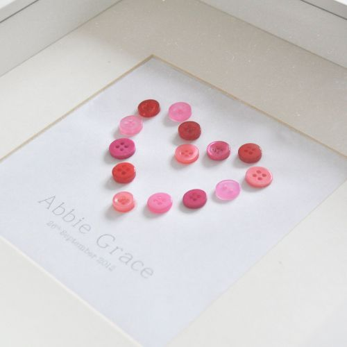 Say it with hearts! This #Personalised Baby Gift Button Heart Picture makes a special gift for a #new baby or a #Christening. This beautiful piece of wall art is brought to you by #PocketFullofPosies. The heart is made from pretty pink buttons and the picture can be #personalised with the #name and #date-of-birth. This white framed picture measures 25cm x 25cm x 4.5 cm and would look lovely on a #nursery wall.