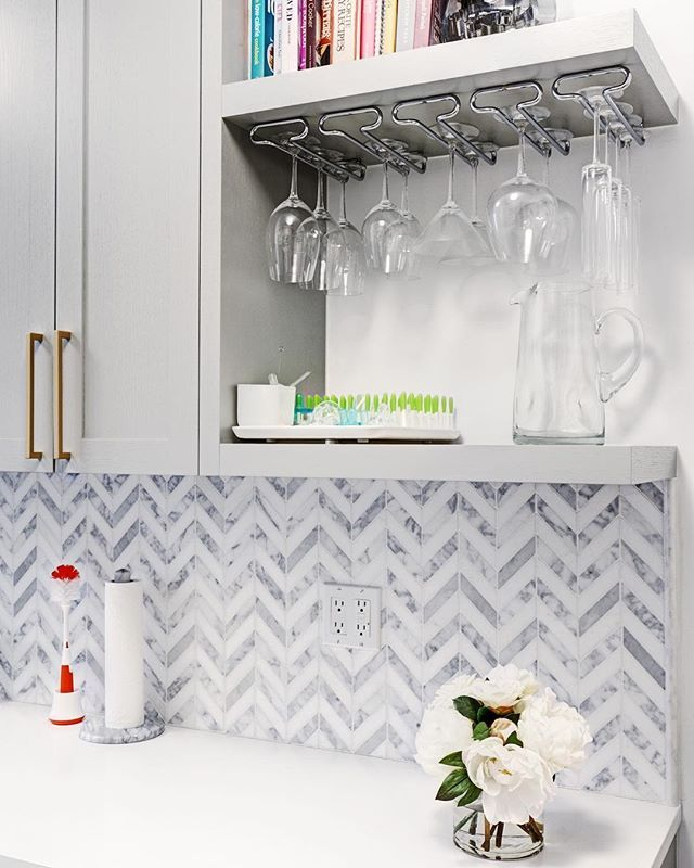 This high-end marble backsplash costs around the price of a monthly gym membership per square foot. If you're looking to save, you can find backsplashes that cost as much as an ice cream cone per square foot.