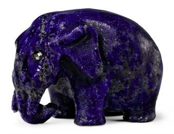 A Carved Lapis Lazuli Model of an Elephant  By Fabergé, circa 1900  Realistically carved, with rose-cut diamond eyes  1 in. (2.5 cm.) long