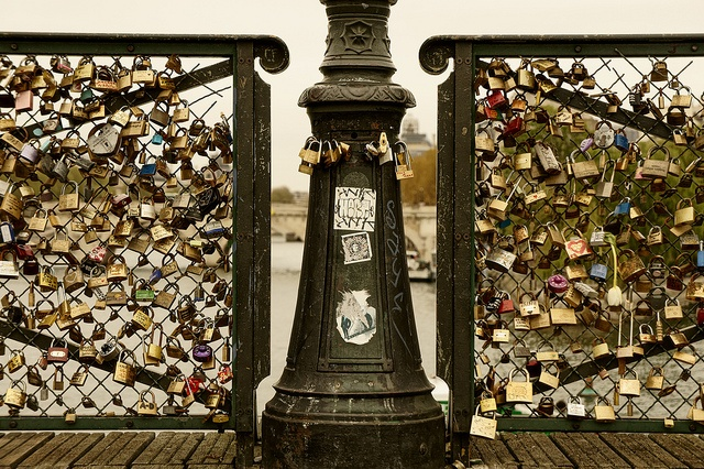 Lock bridge, Paris, France. Attach a padlock with you and a best friend/lover's name on it, and throw the key into the river for eternal love. Bucket list!!!!!!!!!