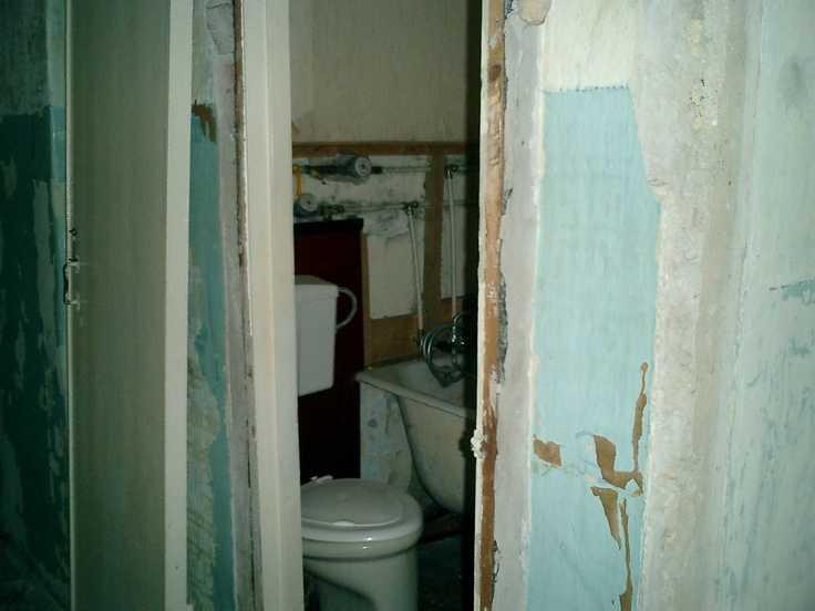 View into original bathroom before walls were removed and the property was stripped. See the finished apartment at LuxHighTech