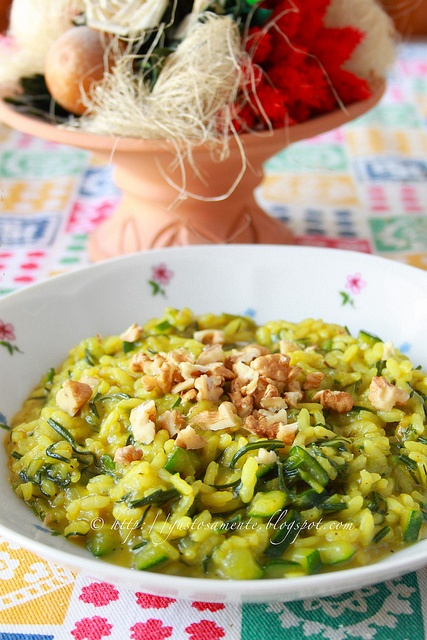 Spring Risotto with agretti, zucchini, curry powder and chopped nuts