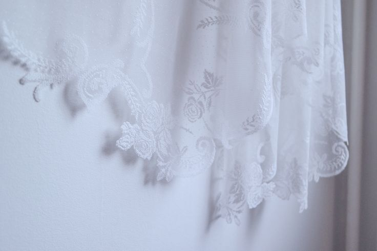 As gentle waves in clear water, the scalloped lace edges of Yara creates a dreamy silhouette when you turn around to meet her. She is a fingertip length square cut veil, all in gorgeous lace with regular scallop edges down both sides, and a handmade scalloped edge finishing off the bottom hem. With the delicate lace she breathes vintage romantic charm, in a calm rather then dramatic way. Photo: Teres Arvidsson & Wernerskapet Model: Christine