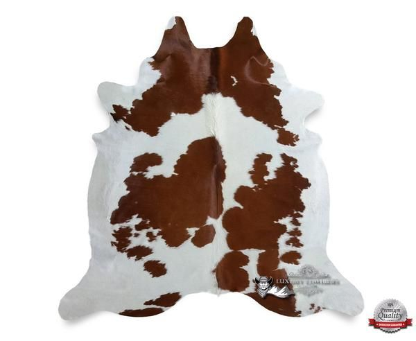 "Cowhide Rug Bring out the Cowboy in you by adding a Homey Western feel to your living room. These rugs are great in any rustic, western or cabin inspired setting. Its premium texture offers ""Sink-In"" underfoot softness while bringing a beautiful difference in your home. Brown and White Cowhide Rug - Origin: Brazil"