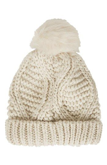 cable knit pompon beanie in cream.