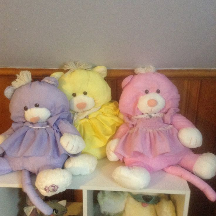 Fisher Price Puffalump cats, purple, yellow, and pink