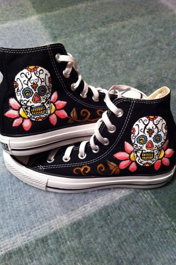 For those of you out there who love skulls as much as I do. These shoes were inspired by Mexican sugar skulls! Looking for different colours? Shoot me a message and we can work something out. Symbols shown in the skull can be changed at your request.    These converse are hand painted with flexible acryllic paint that holds up against weather and cracking