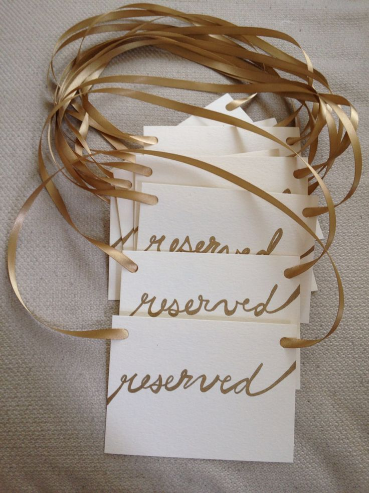"Simple ""reserved"" wedding signs to hang off a row of chairs. All materials from the Paper Source: Flat 4-bar envelopes, vintage gold ribbon, gold metallic sharpie. #wedding #gold #reserved"