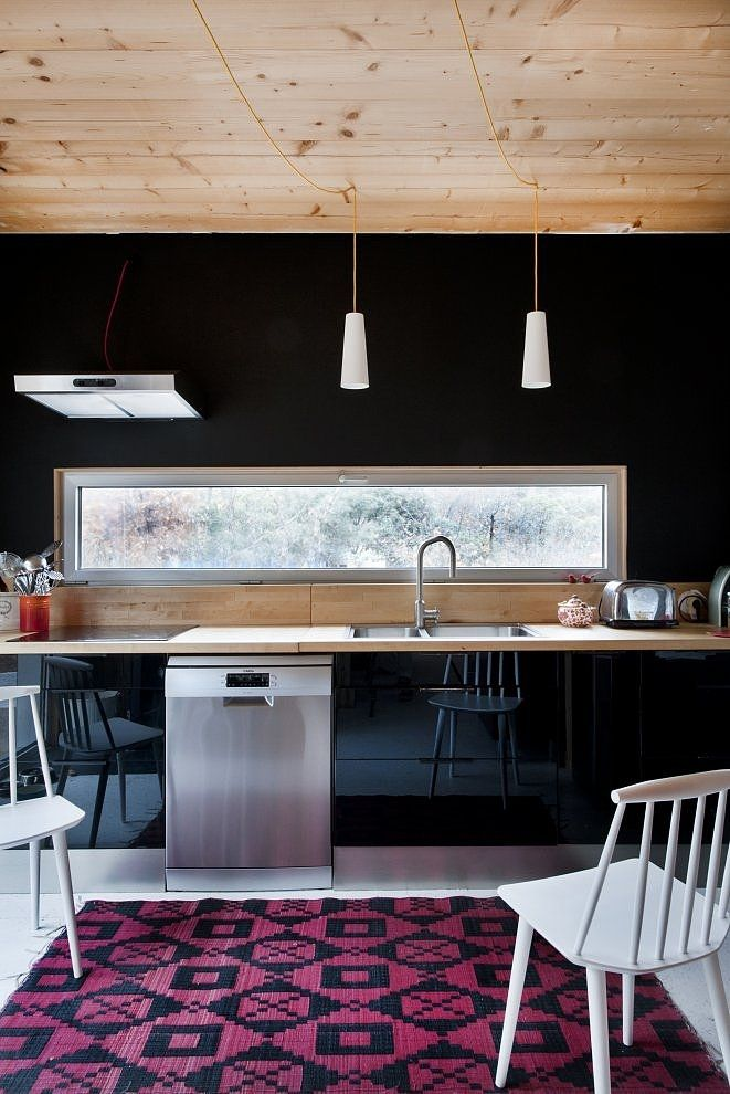 black with pink accents kitchen space