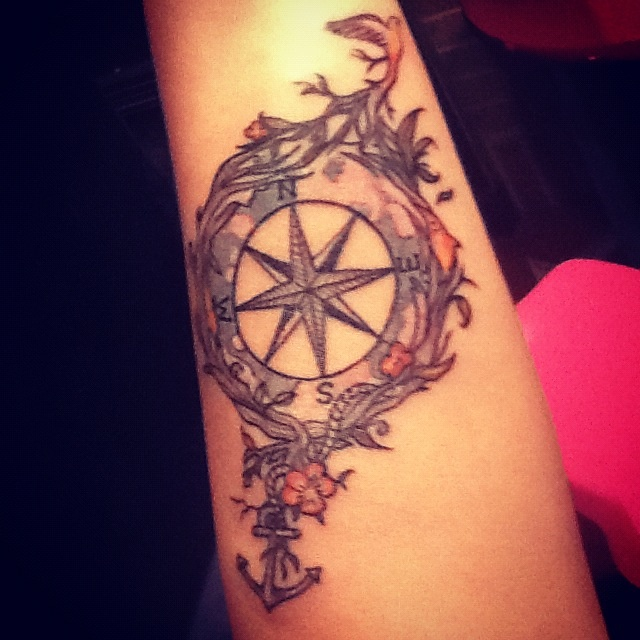 beautiful compass tattoo... love the colours .. throw in a lotus, swallow, arrow wrapping around some branch maybe
