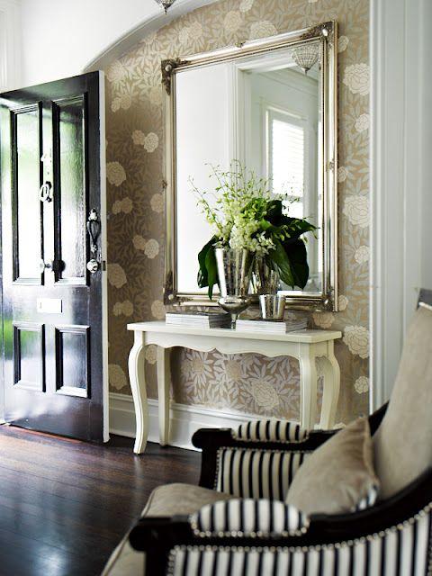 Gloss black door, beautiful botanical paper, enormous mirror. YES.