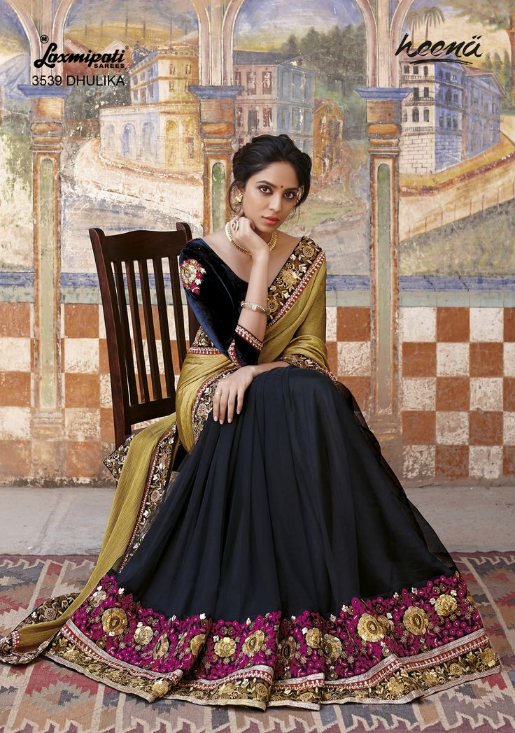 Royal Satin chiffon cum net saree with antique heavy jari and resham work carrying velvety Patched blouse.