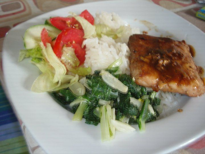 Teriyaki fish with greens, salad and basmati rice